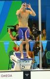 Olympische kampioen Michael Phelps van Verenigde Staten vóór het de hutspotrelais van Mensen 4x100m van Rio 2016 Olympische Spele Stock Foto