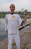 Olympische Torchbearer Paul Giblin, Royalty-vrije Stock Foto's