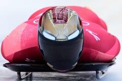 Olympischer Meister Sungbin YUN von Südkorea konkurriert in der Skeleton Mann-offiziellen Trainings-Hitze an den 2018 Winter Olym stockfoto
