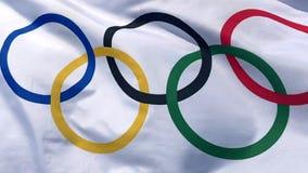Olympisk flagga som fladdrar ultrarapid arkivfilmer