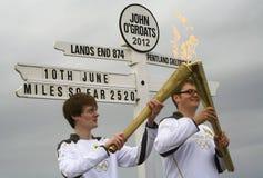 Olympisk flamma och facklor 2012, John O'Groats Arkivbilder