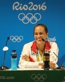 Olympisk mästare Monica Puig av Puerto Rico under presskonferens efter seger på finalen för singlar för tenniskvinna` s av Rio de Arkivbilder