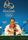 Olympisk mästare Monica Puig av Puerto Rico under presskonferens efter seger på finalen för singlar för tenniskvinna` s av Rio de Fotografering för Bildbyråer