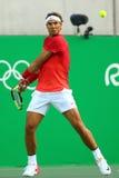 Olympisk mästare Rafael Nadal av Spanien i handling under mäns kvartsfinalen för singlar av Rio de Janeiro 2016 OS Arkivbilder