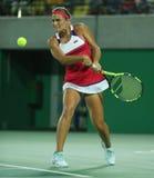 Olympisk mästare Monica Puig av Puerto Rico i handling under tenniskvinnors finalen för singlar av Rio de Janeiro 2016 OS Arkivfoton