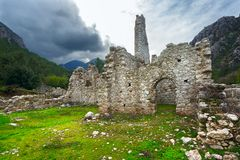 Olympos antique city, ruins. The landscape of the ancient city of Olympos. With the remaining ruins of walls, towers and arched entrances. Turkey Royalty Free Stock Photos