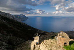 Olympos is a village on the island of Karpathos in the dodec. The last windmill still active on the west coast of the village of olympos. The view over the Royalty Free Stock Images