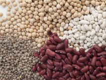 A handful of vegetables seen from the top and composed of chickpeas. Red beans, white beans and lentils royalty free stock image