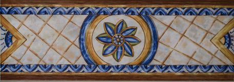 Detail of the traditional tiles from facade of old house. Decorative tiles.Valencian traditional tiles. royalty free stock image