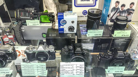 Olympus Digital Camera. Olympus Digital DSLR cameras on a front window store display of professional camera bodies and hi-tech lenses and other accessories and royalty free stock photo