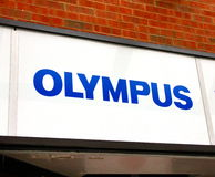 Olympus Logo. An Olympus logo outside a photography store Stock Photo