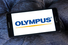 Olympus logo. Logo of camera manufacturer olympus on samsung mobile phone a5 Royalty Free Stock Photography