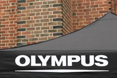 Olympus logo on a tent. Odense, Denmark - August 19, 2017: Olympus logo on a tent. Olympus is a Japanese manufacturer of optics and reprography products Stock Photo