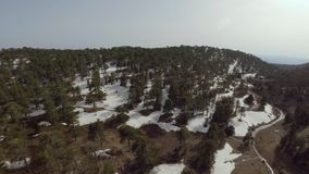 Olympus peak on mount Troodos. Aerial shot of snowy peak of mount Troodos in Cyprus stock footage
