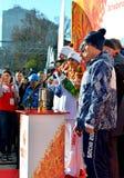 Olypmic冠军有奥林匹克火炬的塔蒂亚娜Navka 图库摄影