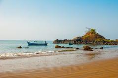 Om beach. Boats of fishermen. Gokarna, Karnataka, India. Beautiful beach with rocks and blue sea. Om beach, Gokarna, Karnataka, India Stock Image