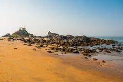 Om beach. Boats of fishermen. Gokarna, Karnataka, India. Beautiful beach with rocks and blue sea. Om beach, Gokarna, Karnataka, India Royalty Free Stock Photos