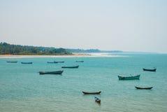 Om beach. Boats of fishermen. Gokarna, Karnataka, India. Beautiful beach with rocks and blue sea. Om beach, Gokarna, Karnataka, India Royalty Free Stock Photo