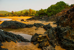 Om beach, Gokarna, Karnataka, India. Beautiful beach with rocks and blue sea. Om beach, Gokarna, Karnataka, India Stock Image