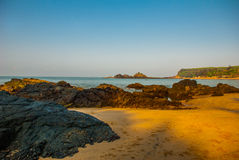 Om beach, Gokarna, Karnataka, India. Beautiful beach with rocks and blue sea. Om beach, Gokarna, Karnataka, India Royalty Free Stock Images