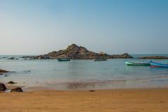 Om beach, Gokarna, Karnataka, India. Beautiful beach with rocks and blue sea. Om beach, Gokarna, Karnataka, India Stock Images