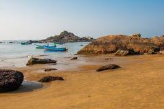Om beach, Gokarna, Karnataka, India. Beautiful beach with rocks and blue sea. Om beach, Gokarna, Karnataka, India Royalty Free Stock Photo