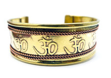 Om brass bracelet. Brass and copper OM Symbol bracelet isolated on white Stock Photos