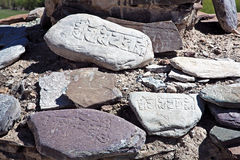 Om mani Padma Hums engraved on stones, Ladakh, Jammu and Kashmir, India. Royalty Free Stock Image