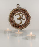 Om sign with burning candles - Indian special mantra Stock Image