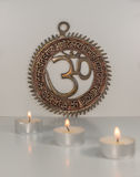 Om sign with burning candles - Indian special mantra Stock Images