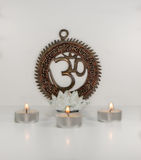 Om sign with lotus burning candles - Indian special mantra Royalty Free Stock Photography