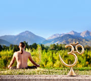 Om statue and meditation Royalty Free Stock Image