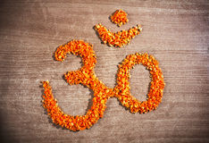 Om symbol from chopped carrot Royalty Free Stock Image