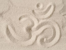 Om symbol in sand. Om symbol written in sand, view from above, have a break or meditation concept Stock Photos