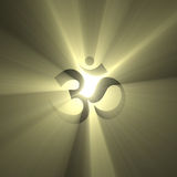 OM symbol shinning light halo flare. The OM (Aum) sign shining with powerful light halo effect. The most sacred mantra in Hinduism and Tibetan Buddhism. Extended Stock Photography