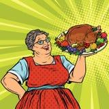 Oma met een Kerstmis of Dankzeggingsbraadstuk Turkije Stock Afbeeldingen