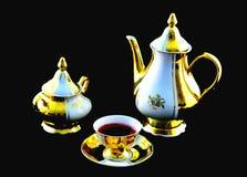 Oma` s uitstekend theestel, wit en gouden porselein Stock Foto