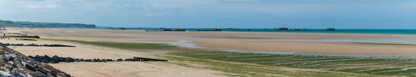 Omaha beach panorama. Omaha Beach with ruins of WW II in a sunny day - Normandy (France) 2012 royalty free stock images