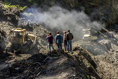 Omalo, Georgia. Workers remove the landslide on the mountain road. Tusheti royalty free stock photo