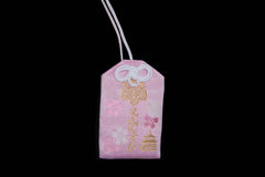Omamori - Japanese charm. This is an Omamori or a Japanese charm that bring luck in love to its owner Royalty Free Stock Images