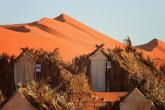 Oman: accomodation in desert. Traditional cabins as earthy accommodation in Wahiba Sands stock photos