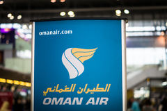 Oman Air logo signboard at check-in counter Stock Images
