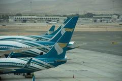 Oman Air-Vliegtuig in Muscateldruif, Oman royalty-vrije stock afbeeldingen