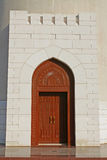 Oman, architecture representing a wooden doorway. Typical detail of architecture in Oman representing an old arched doorway Royalty Free Stock Photography