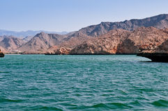 Oman: Bandar Kayran. The area of Bandar Kayran has the largest semi-enclosed bay on the western coast of Oman.  It is surrounded by steep rocky hills and cliffs Royalty Free Stock Photography