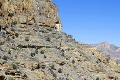 Oman berglandskap av den omanska stora kanjonen Royaltyfri Bild