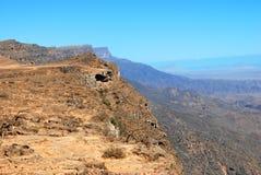 Oman berglandskap av den omanska stora kanjonen Royaltyfri Foto