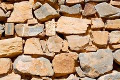 in Oman die alte Wand nahe errichtender Zusammenfassung des Hauses und des Blockes Stockbilder
