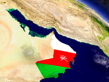 Oman with embedded flag on Earth Royalty Free Stock Images