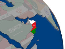 Oman with flag on globe Royalty Free Stock Image